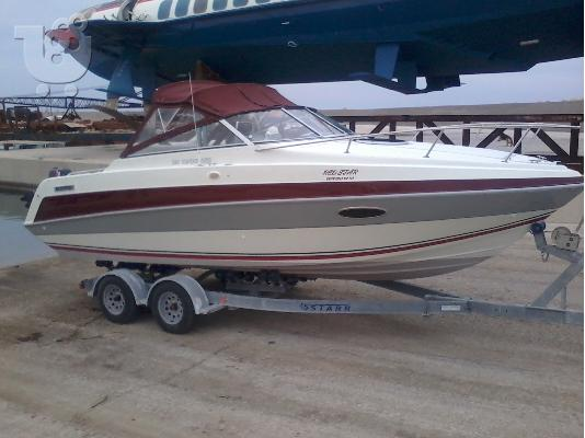 PoulaTo: Four Winns 225 Sundowner Storm Boat